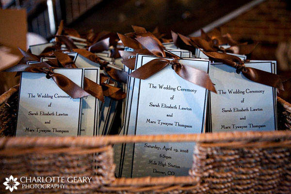 Blue wedding programs with brown ribbons