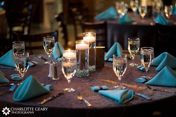 Wedding reception table set with brown and blue linens