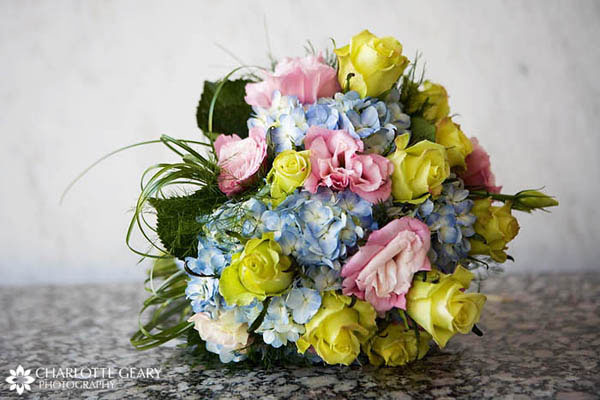 Bridal bouquet with blue hyacinths and yellow and pink roses