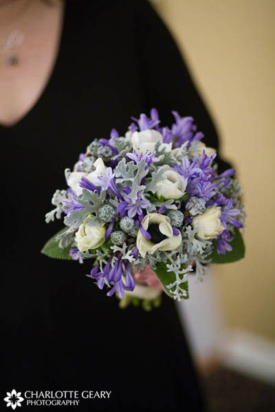 Bridesmaid with purple and green bouquet for a winter wedding
