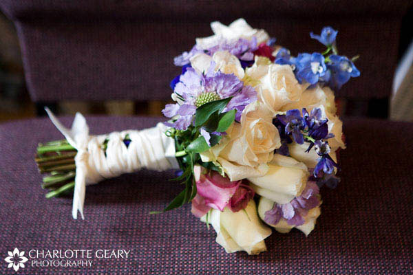 Bridal bouquet with white, blue, and purple flowers