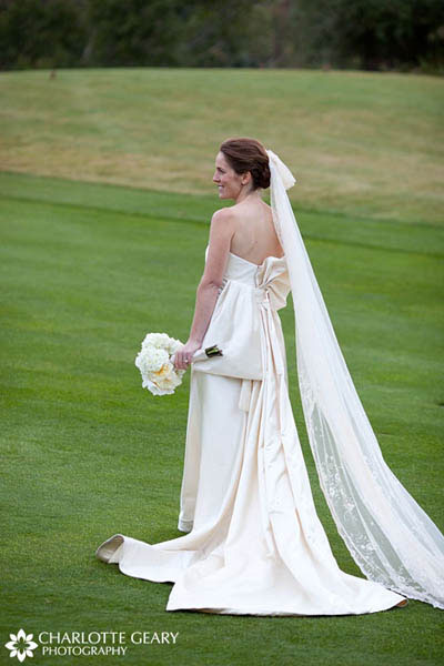 White in a kimono-style wedding gown with a long veil and white bouquet