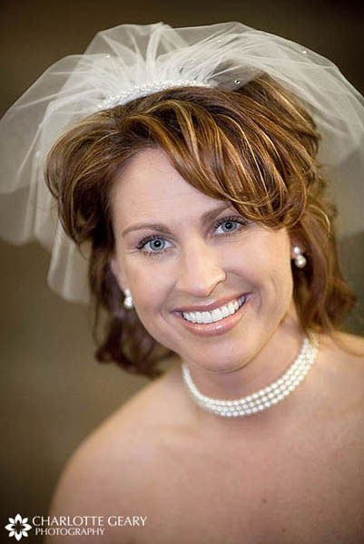 Bride in shoulder-length veil
