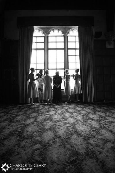 The bridesmaids in the bridal suite at Glen Eyrie castle in Colorado Springs