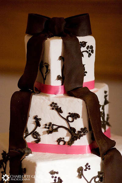 Pink and brown wedding cake with subtle dog paw decorations among the icing, for a couple who loves dogs