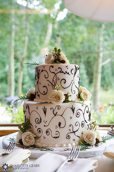 Two-tiered wedding cake with brown and green decoration