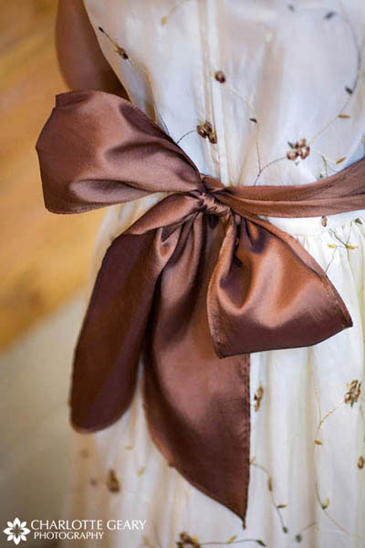 Brown sash on a flower girl dress