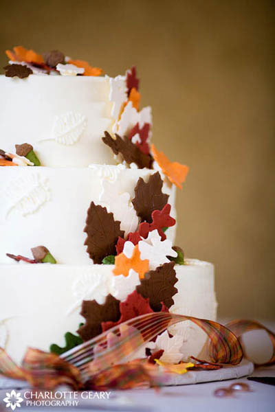 Autumn wedding cake with sugar leaves in red, orange, and brown