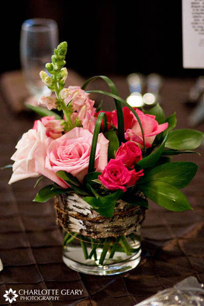Pink rose centerpieces tied with brown bark