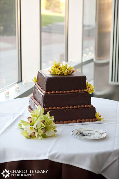 Brown chocolate wedding cake with green orchids