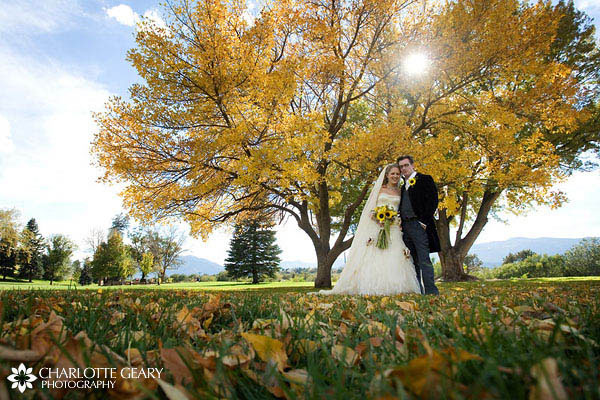 Bride and groom in the autumn leaves