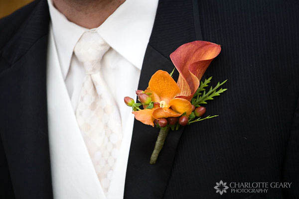 Orange boutonniere with orchid and calla lily