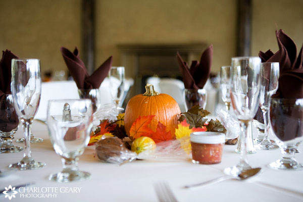 Pumpkin centerpiece at an autumn wedding reception