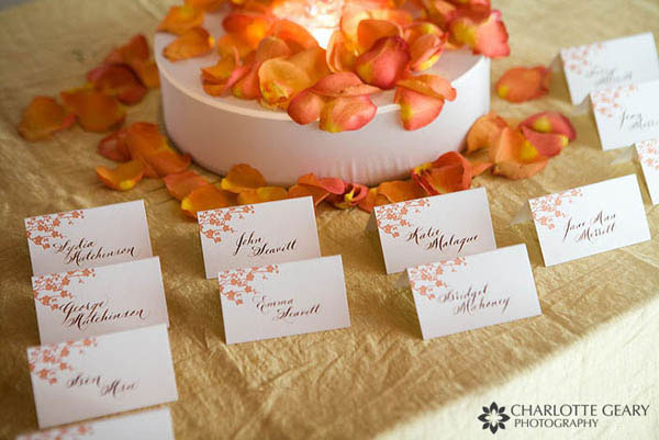 Wedding escort cards with orange autumn leaves