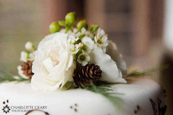 Wedding cake topper with pine cones