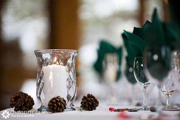 Pine cone and candle centerpiece at a winter wedding reception