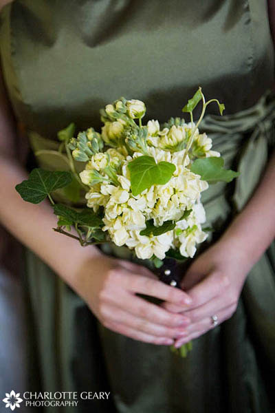 Bridesmaid in green dress with green and white bouquet