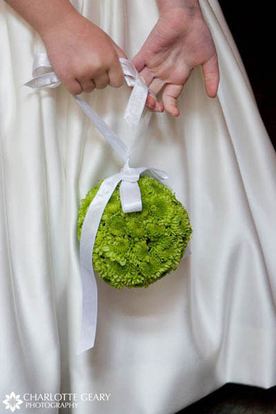 Flower girl with a green pomander kissing ball