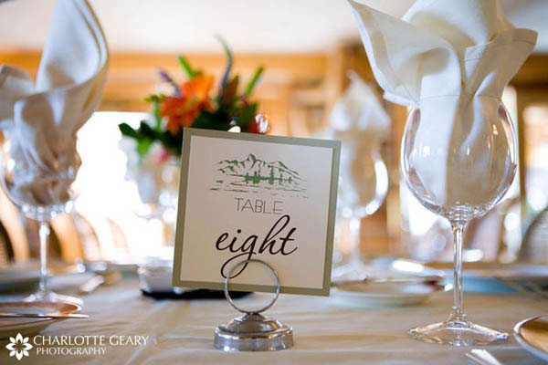 Table numbers with light green trim and mountain illustration
