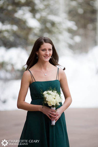 Bridesmaid in dark green dress