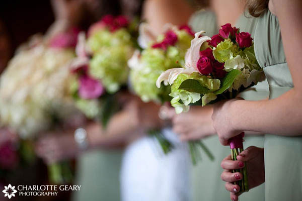 Bridesmaids with green and pink bouquets
