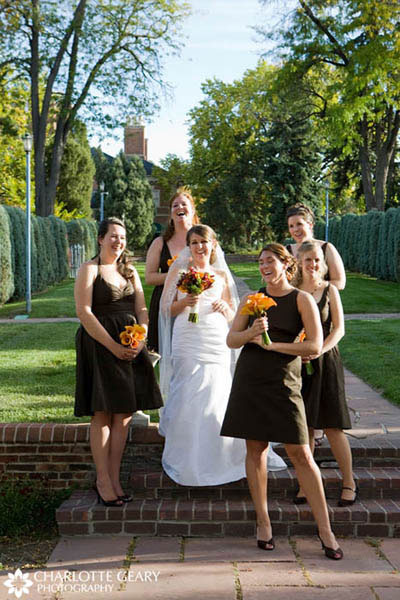 Bridesmaids with brown dresses and orange flowers