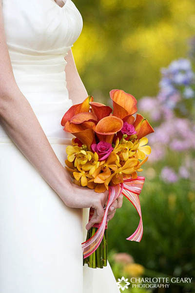 Orange and yellow bridal bouquet with orchids and calla lilies