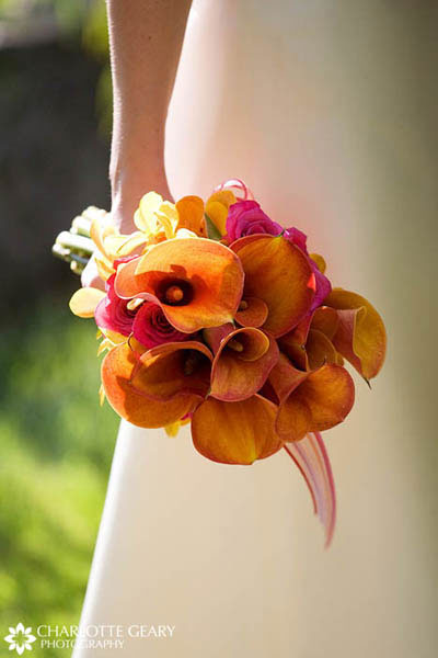 Orange and pink bouquet of calla lilies