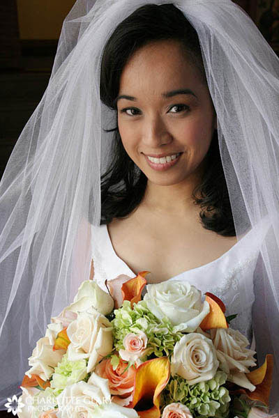 Bride with orange and yellow autumn bouquet