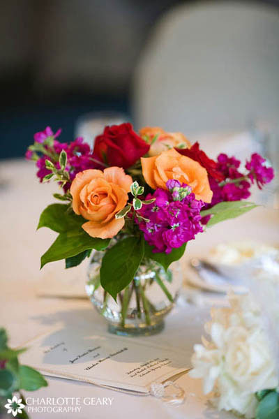 Centerpiece of orange, pink, and red flowers