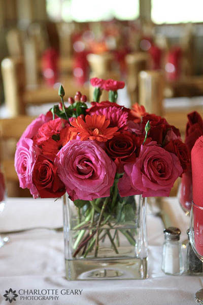 Red, pink, and orange rose centerpiece