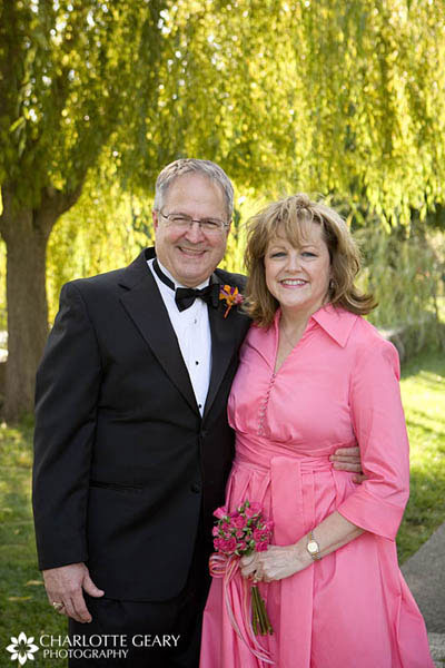 Father and mother of the bride in pink