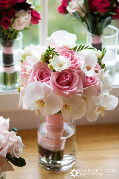 Pink and white bouquet with roses and orchids