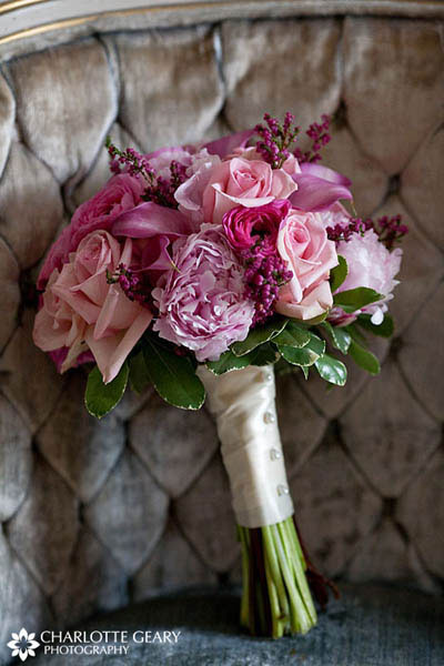 Pink bridal bouquet with roses, peonies, and calla lilies