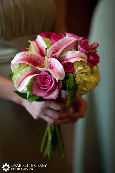 Bridesmaid with green dress and pink and green bouquet of lilies and roses