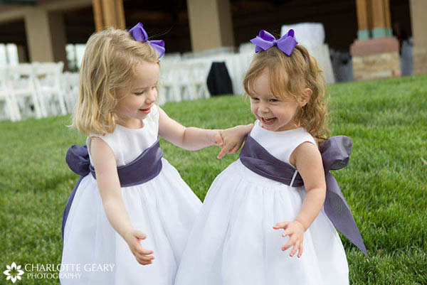 Flower girls with purple sashes and ribbons