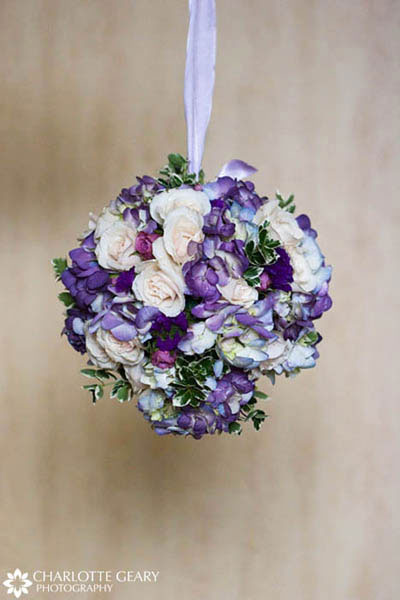 Flower girl pomander of blue and purple flowers