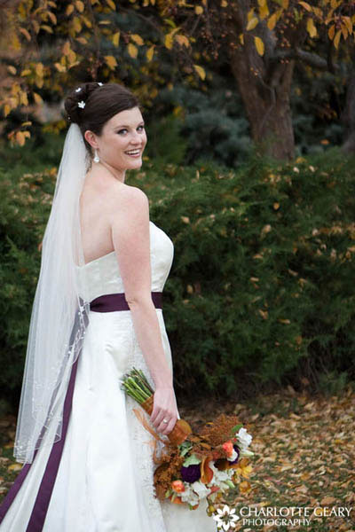 Bride with purple sash and purple and orange flowers
