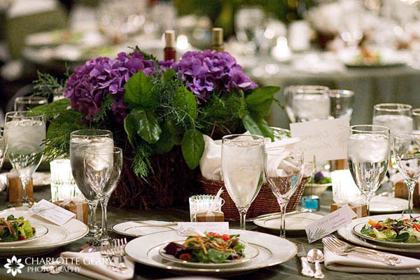 Table set with purple hyacinth centerpiece