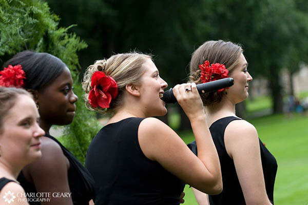 Bridesmaids with red flowers in their hair