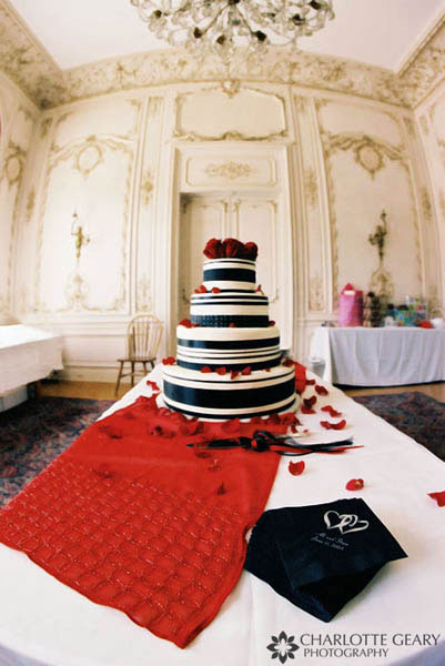 Red, black, and white wedding cake
