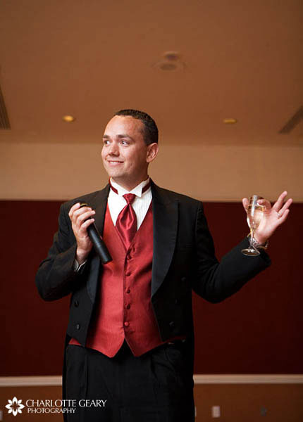 Groomsman in red vest and tie
