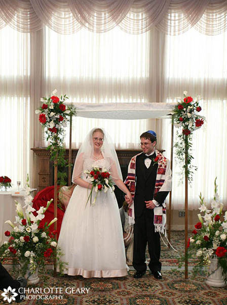 Chuppah decorated with red and white roses