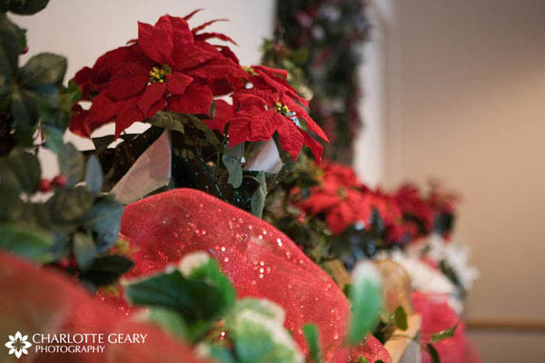 Poinsettia reception decorations for Christmastime wedding