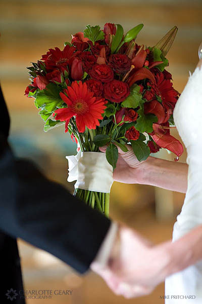 Red bouquet of daisies, lilies, and roses