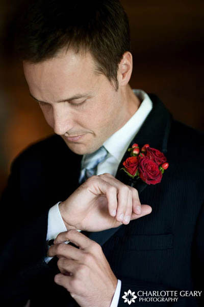 Groom in red rose boutonniere