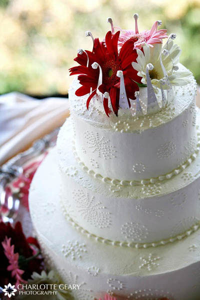 Wedding cake with gerbera daisy topper
