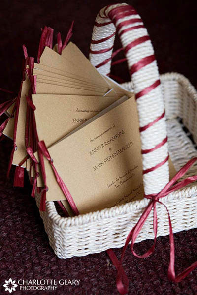 Red and white basket of wedding programs
