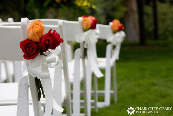 Red and orange rose ceremony decorations