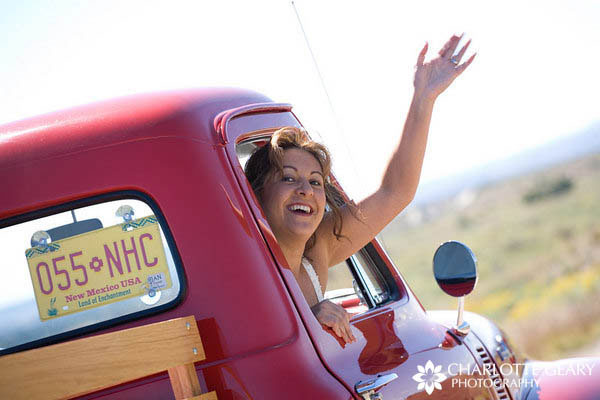 Bride leaving in antique red truck